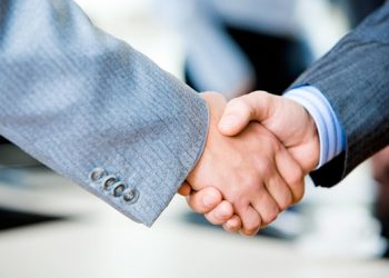 Close-up of two businessmen's handshake
